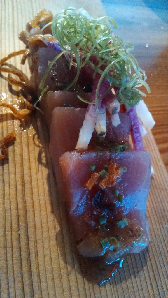 Yellowfin tuna crudo with sesame, mustard, radish