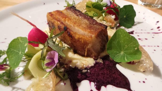 Pork belly with chicharrónes, blueberry gastrique, pickled celery